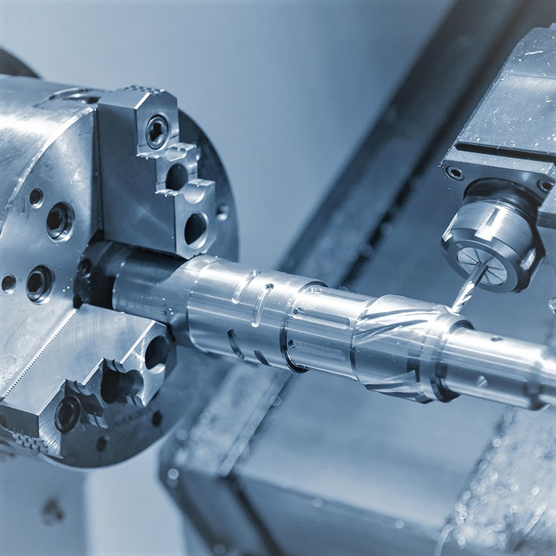 The multi-tasking CNC lathe machine cutting the automotive parts by  milling spindle  with the cutting tools. The automotive parts production processing by CNC turning machine .